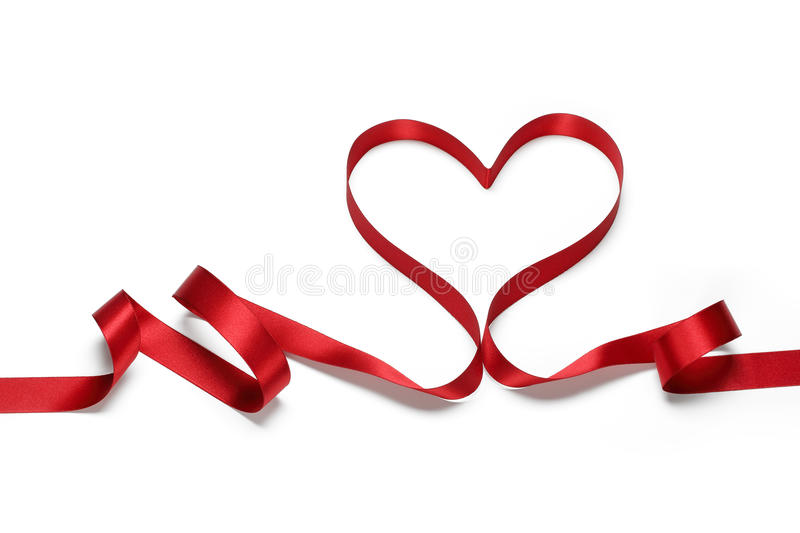 Red ribbon in heart shape royalty free stock photo