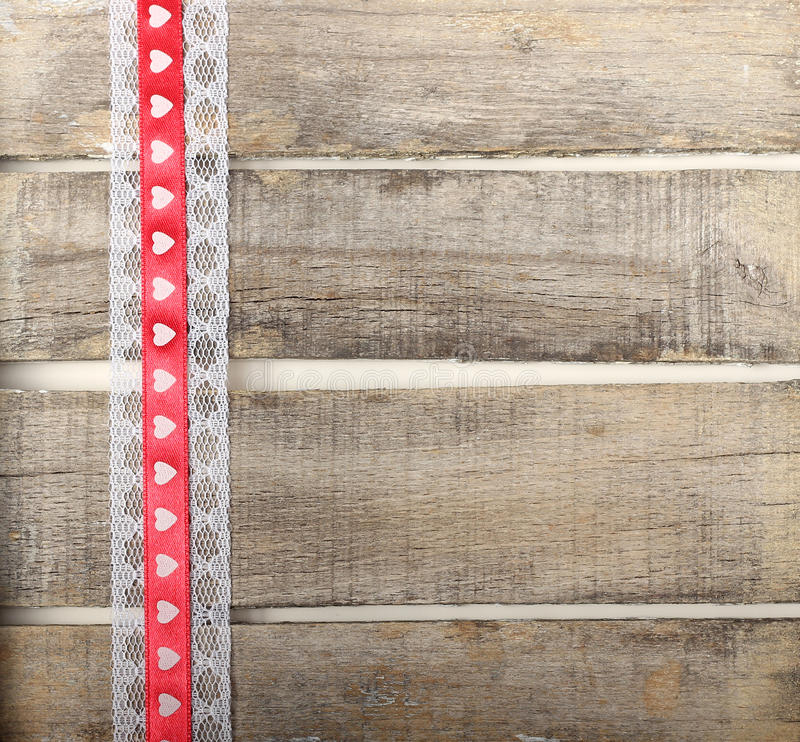 Download Red Ribbon Of Hearts On Old Wooden Background Stock Image - Image: 37678699