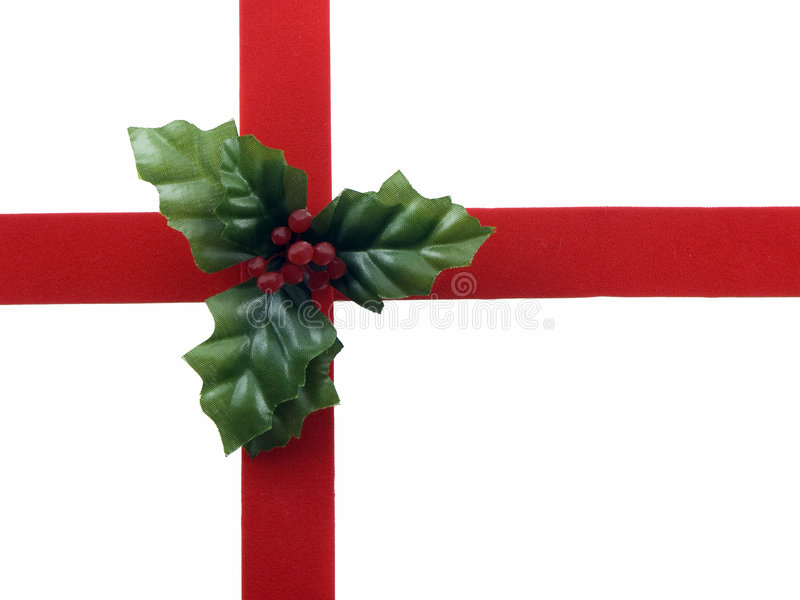 Red ribbon and holly royalty free stock images