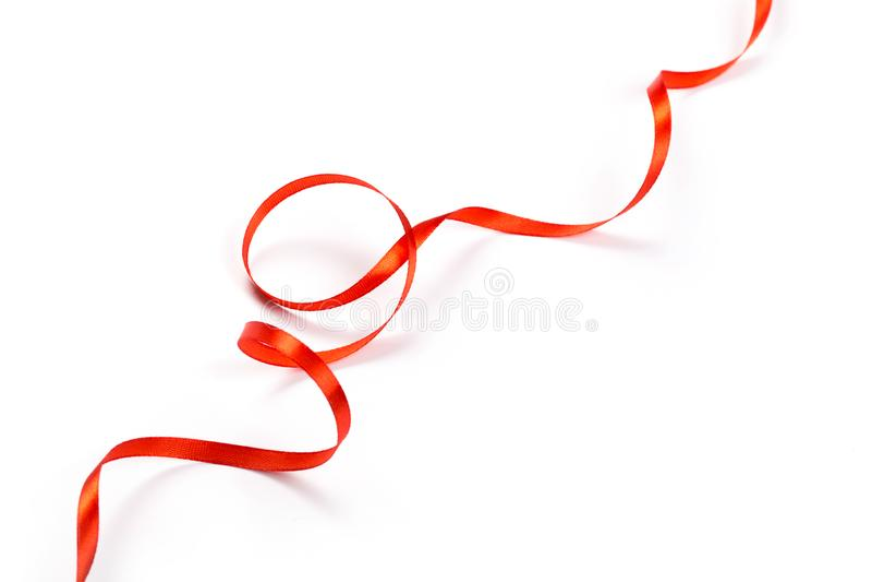 Red ribbon  on white stock image