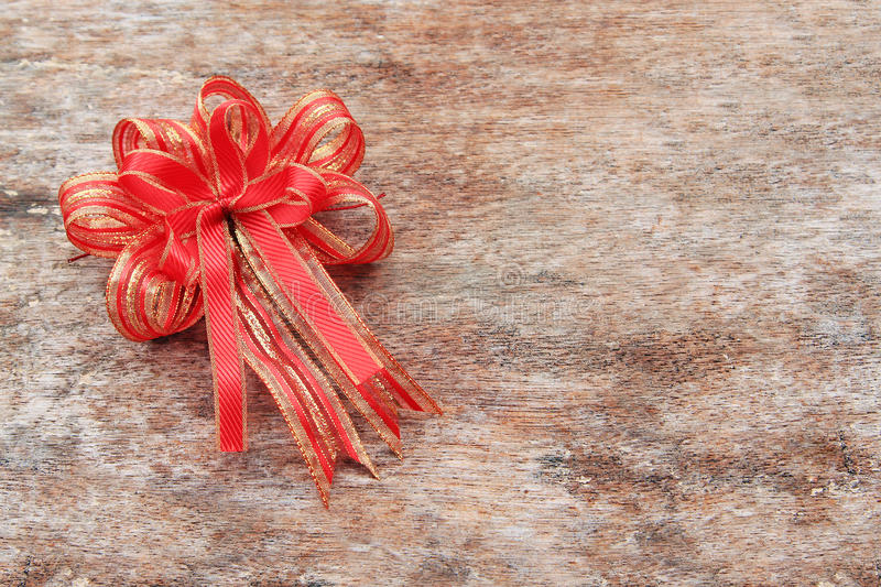 Red Ribbon. On Old Wood Background royalty free stock photography