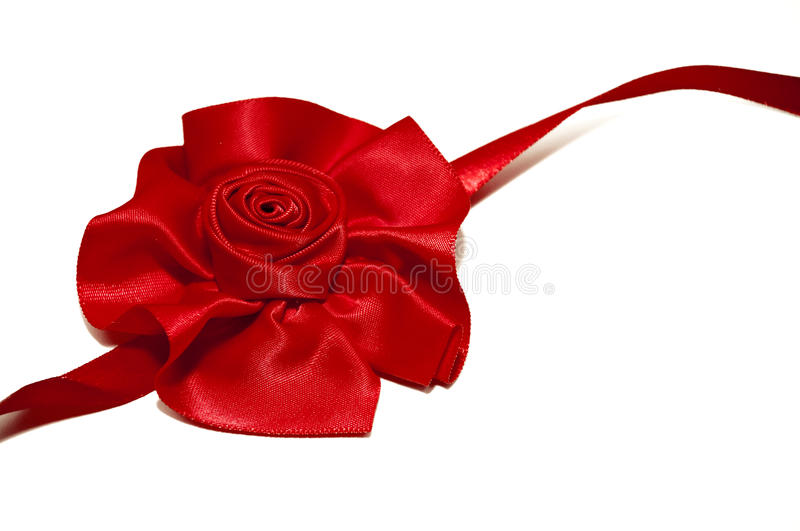 Red ribbon rose. Isolated on white background royalty free stock photo