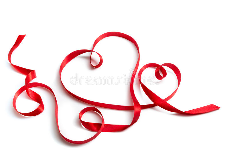 Red ribbon that shape a couple of hearts stock image