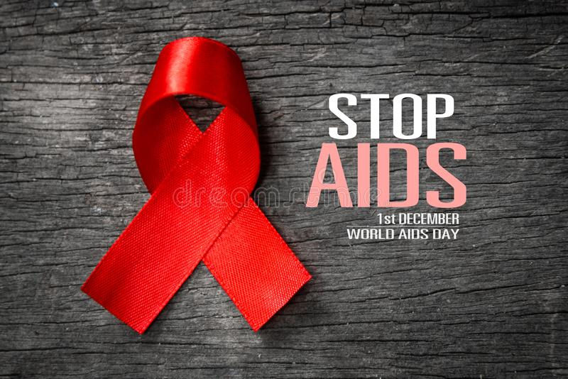 Red ribbon with text world aids day awareness campaign royalty free stock images