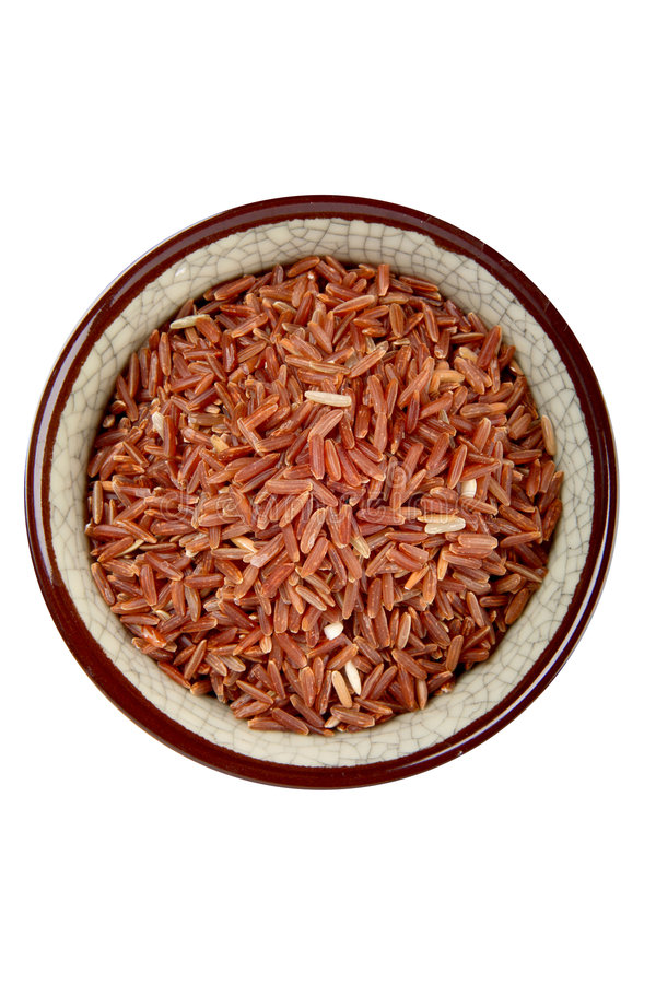 Red rice. Bowl of red rice from Thailand stock photos