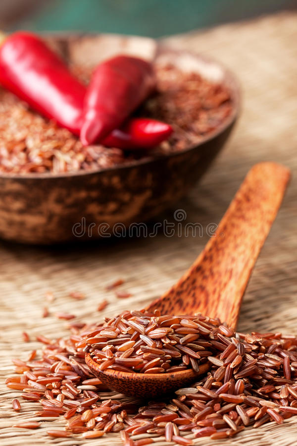 Download Red Rice In A Wooden Spoon Stock Photo - Image: 83702506