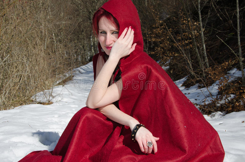 Red Riding Hood in the snow stock photos