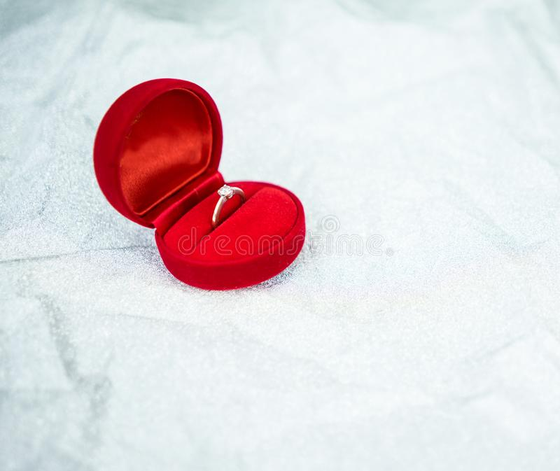 Red ring box with diamond ring for wedding day. Object for valentine day royalty free stock image