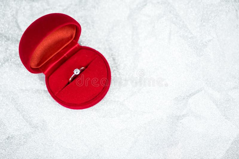 Red ring box with diamond ring for wedding day. Object for valentine day royalty free stock images