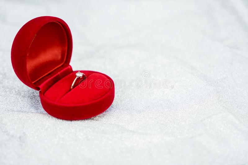 Red ring box with diamond ring for wedding day. Object for valentine day stock images