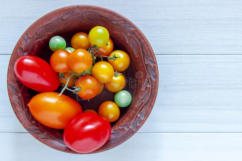 Red, ripe tomatoes in a plate on a white background. Harvesting tomatoes. Top view. royalty free stock image