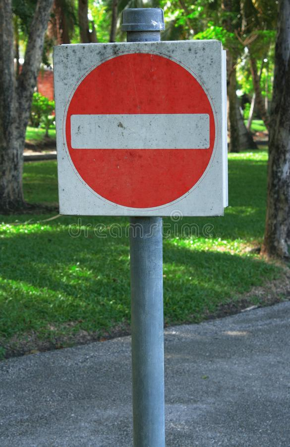 Red road signs, traffic signs on nature. Background royalty free stock photo