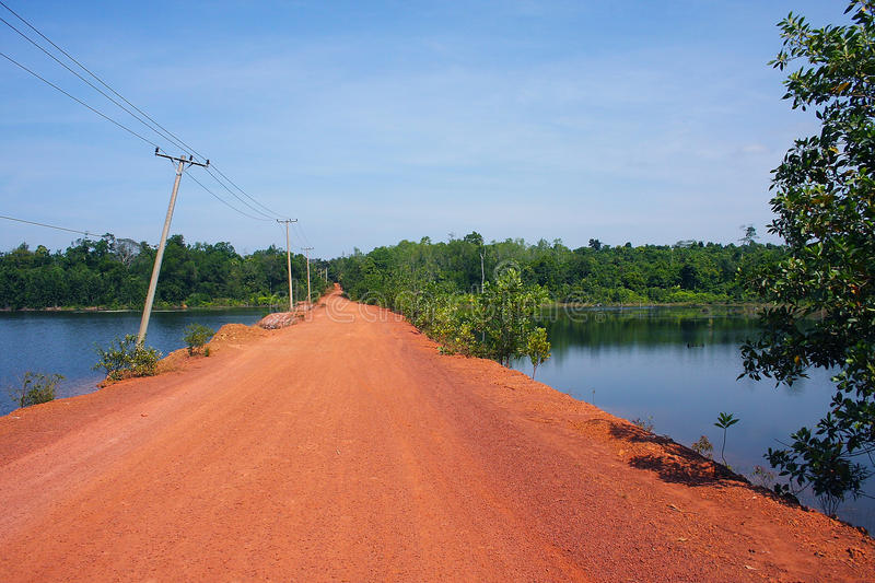 Red road to the waterfall in Cambodia. Near Sihanoukville stock photo