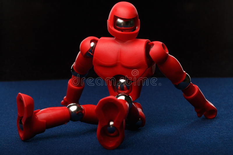 Red robot sitting stock photography