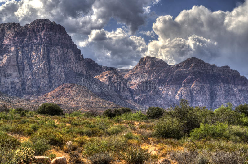 Red Rock Canyon, Desert and Mountains in Nevada. Clouds mountains and desert at Red Rock Canyon National Conservation area in Nevada stock photography
