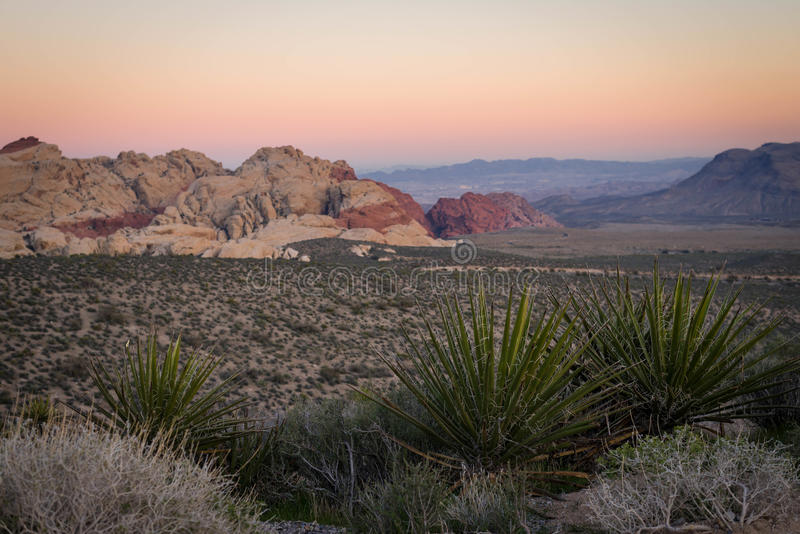 Red Rock Canyon Sunset. The colorful sunset of the southwestern desert brightens the colors of the rock formations in the distance at Red Rock Canyon royalty free stock photo