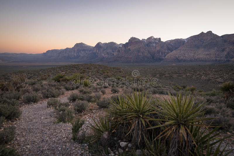 Red Rock Canyon Sunset 2. The colorful sunset of the southwestern desert brightens the colors of the rock formations in the distance at Red Rock Canyon royalty free stock photo