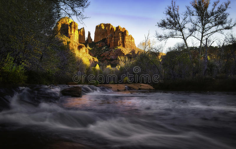Red Rock Crossing, Sedona, Arizona. Cathedral Rock glows in the setting sun at Red Rock Crossing in Sedona, Arizona on Oak Creek, a popular tourist area royalty free stock images