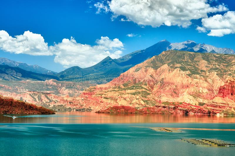 Red rock and green water in west China royalty free stock images