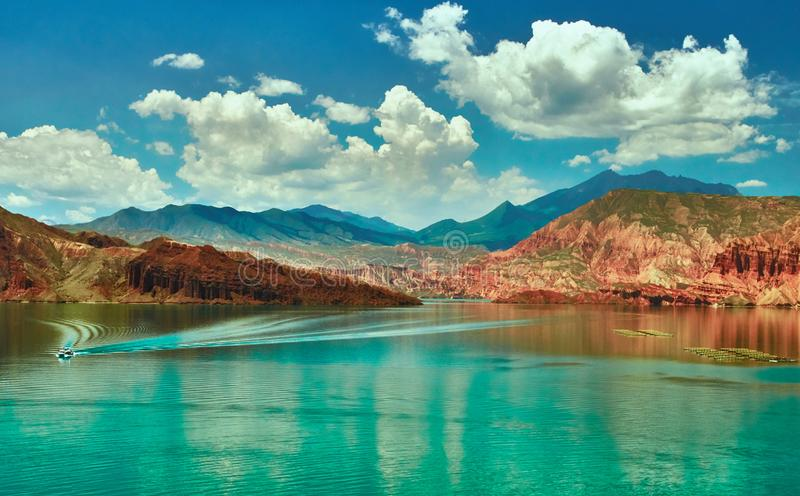 Red rock and green water in west China stock photo