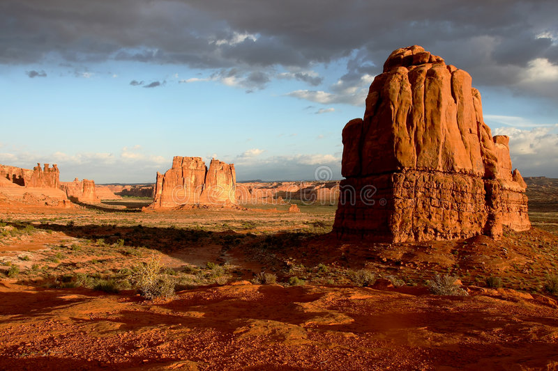 Red Rock Monoliths. Under low clouds at sunrise stock images