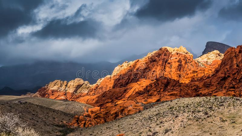 Red Rock Mountain with dramatic sky in the background stock image