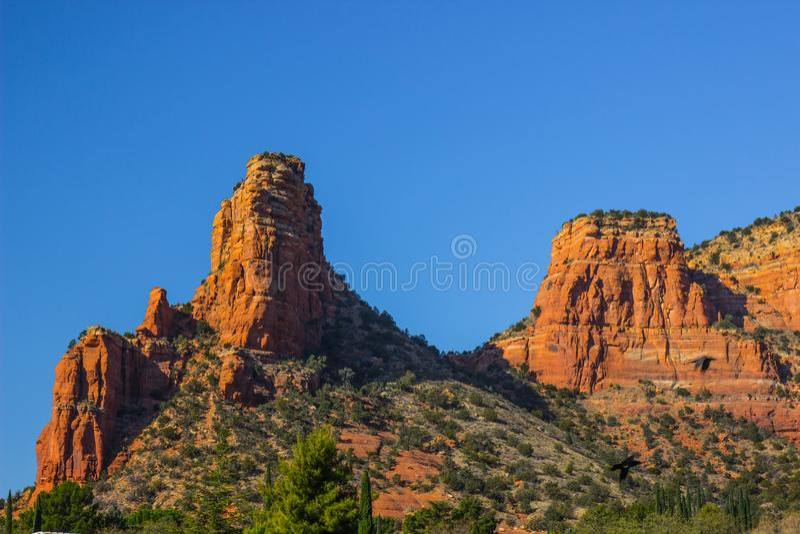 Red Rock Outcroppings in Arizona High Desert. Two Red Rock Mountain Outcroppings In Arizona High Desert Against Blue Sky Background stock image