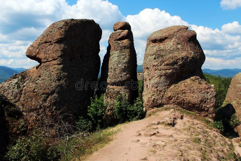 Red rock vertical pillars against blue sky. In summer royalty free stock photos