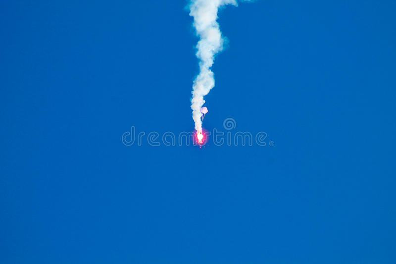 A red rocket and blue sky. An emergency red rocket in the blue sky in an exercise stock photography