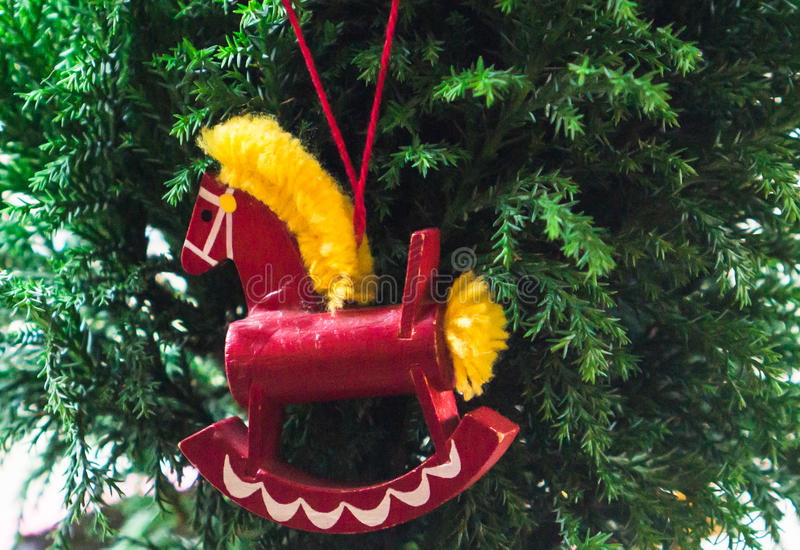 Red rocking horse ornament stock photo