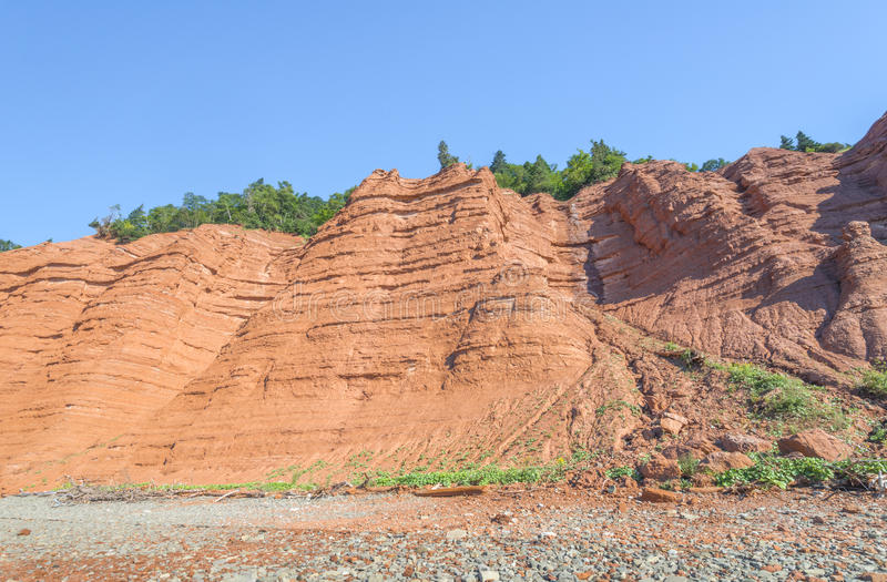 Red rocks of the Blomidon cliffs. The red rocks of the Blomidon cliffs at low tide (Blomidon Provincial Park, Nova Scotia, Canada stock photo
