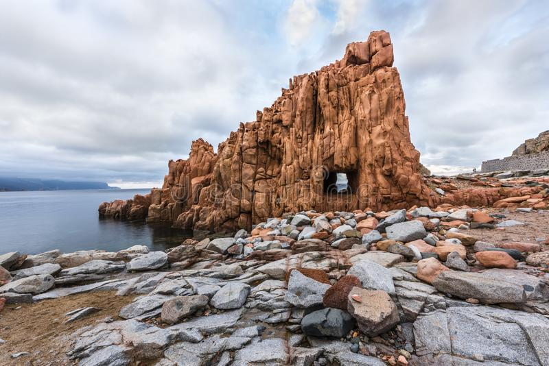 Red Rocks called `Rocce Rosse` of Arbatax with `window`, Sardinia, Italy royalty free stock photography