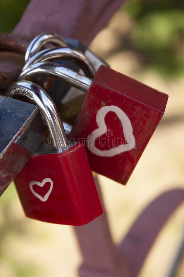 Red Romance locks on the bridge stock images