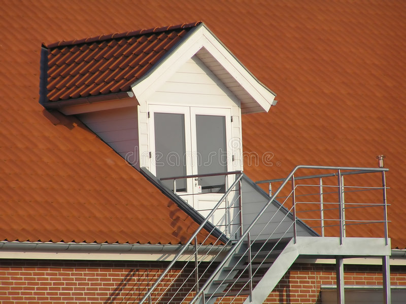 Red roof. With white window and staircase stock images
