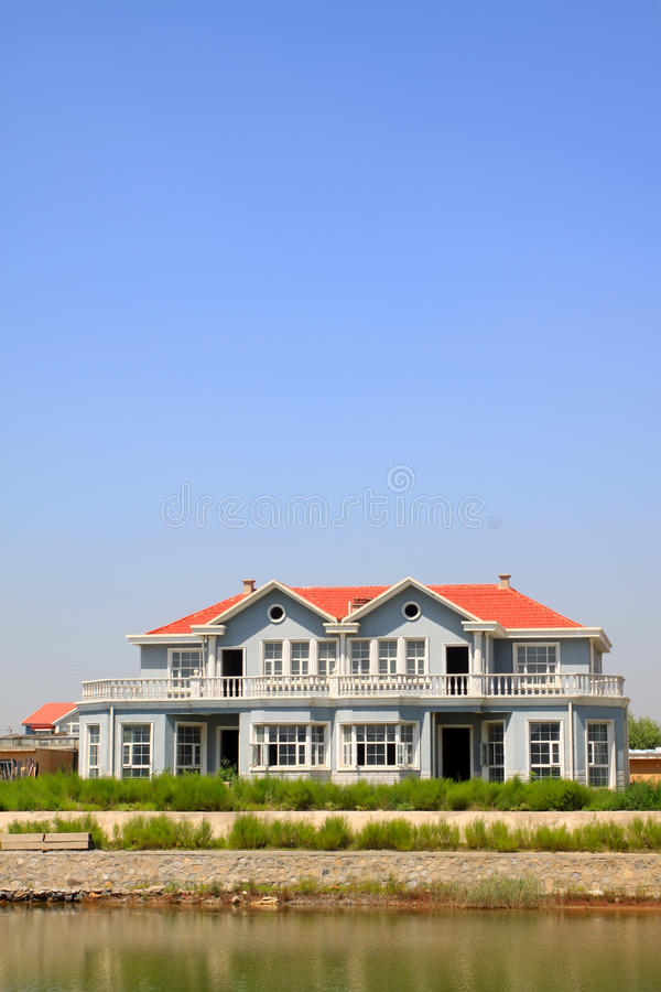 Download Red Roof Building At Water's Edge Stock Image - Image: 23641513