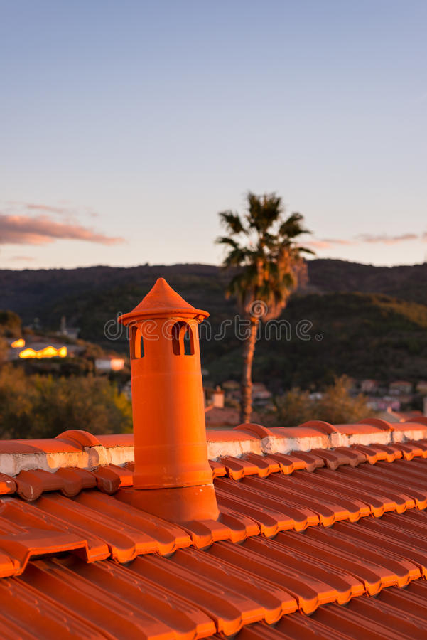 Red roof and chimney royalty free stock photography