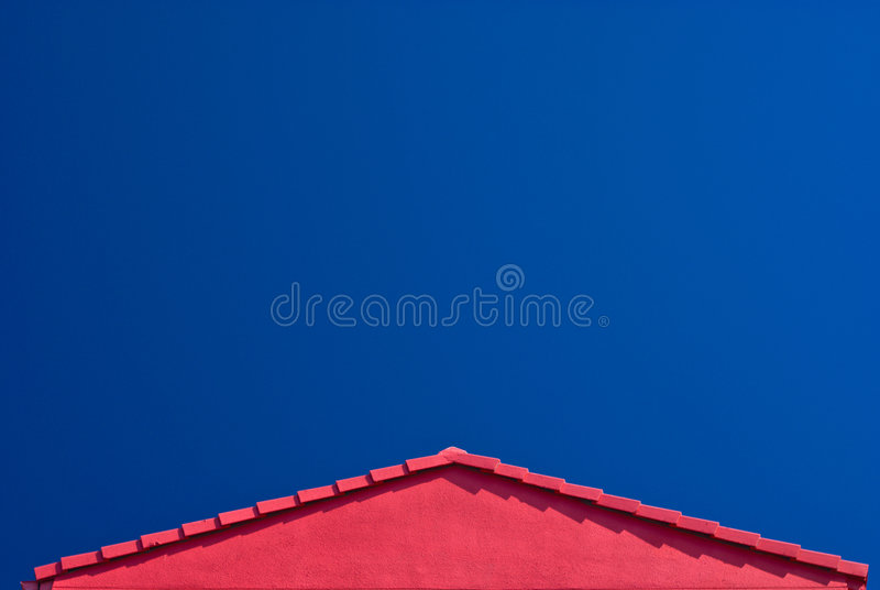 Red Roof Gable and Blue Sky