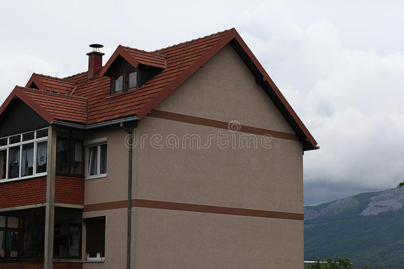 Red roof home among mountains. Landscape in Europe with red roof home among mountains royalty free stock photos