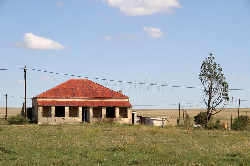 Red Roof house in Edenvale. Old red roof house in Edenvale, Free State. Landscape photo. Blue sky and white clouds royalty free stock photo