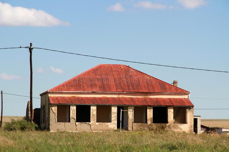 Red Roof house in Edenvale. Old red roof house in Edenvale, Free State. Landscape photo. Blue sky and white clouds royalty free stock photos