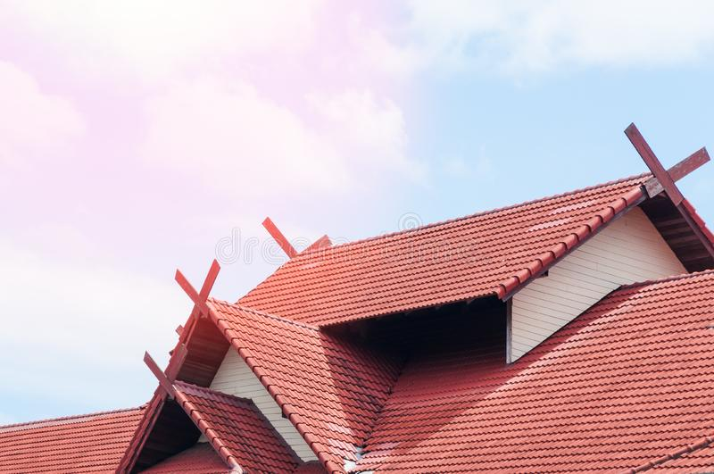 Red Roof house with tiled roof on blue sky royalty free stock photo