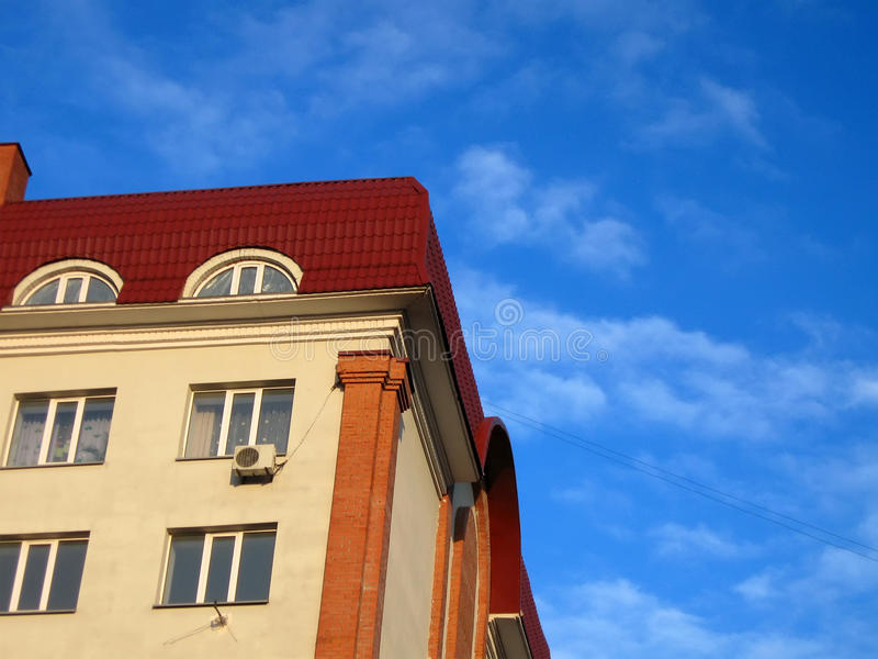 Red roof, new colorful yellow building stock photography