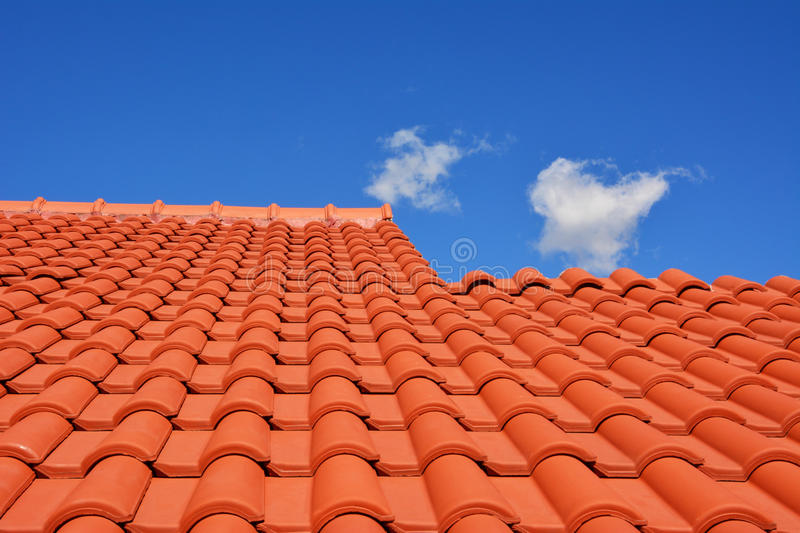 Red roof texture tile. And blue sky with cloud in background royalty free stock images