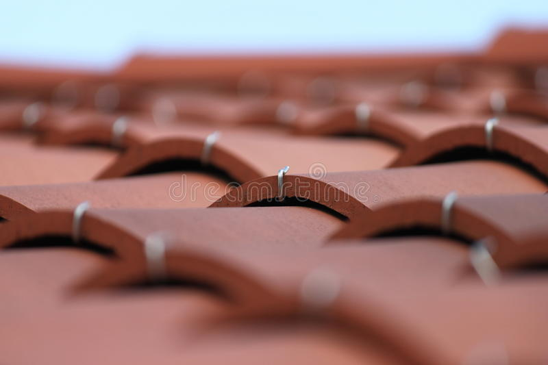 Red roof tiles stock image