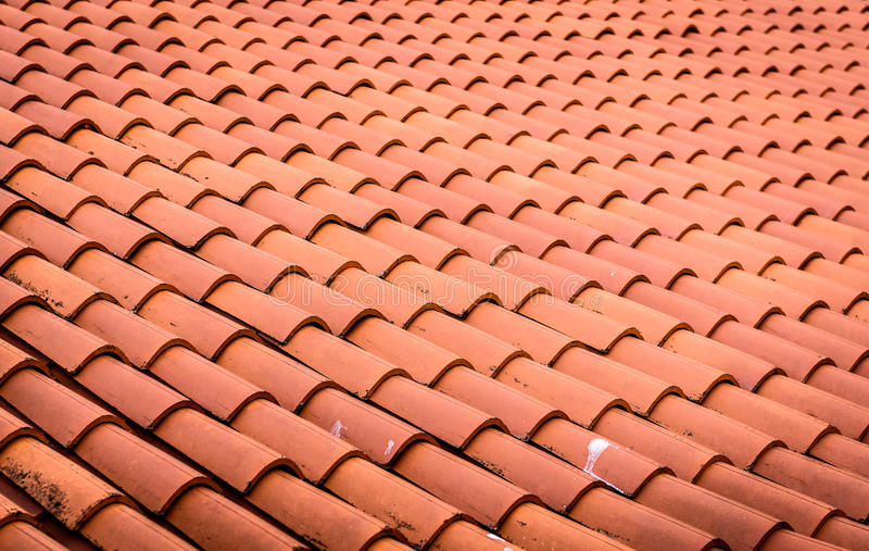 Red roof tiles or shingles on house as background image. royalty free stock photography