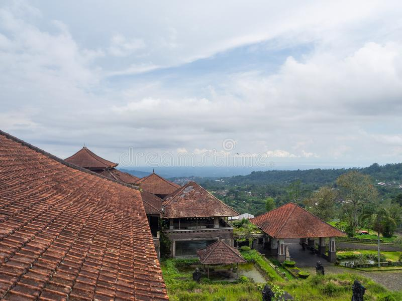 Red roofs of an abandoned hotel in Bali stock photography