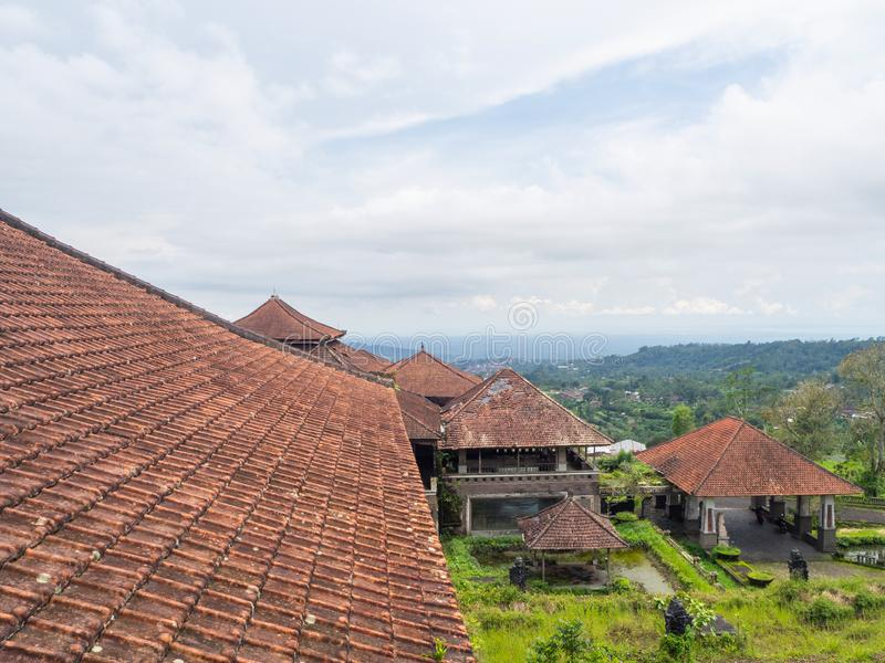 Red roofs of an abandoned hotel in Bali royalty free stock photos