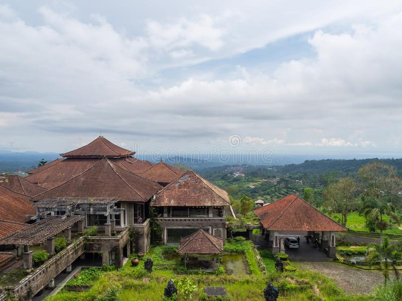 Red roofs of an abandoned hotel in Bali royalty free stock images