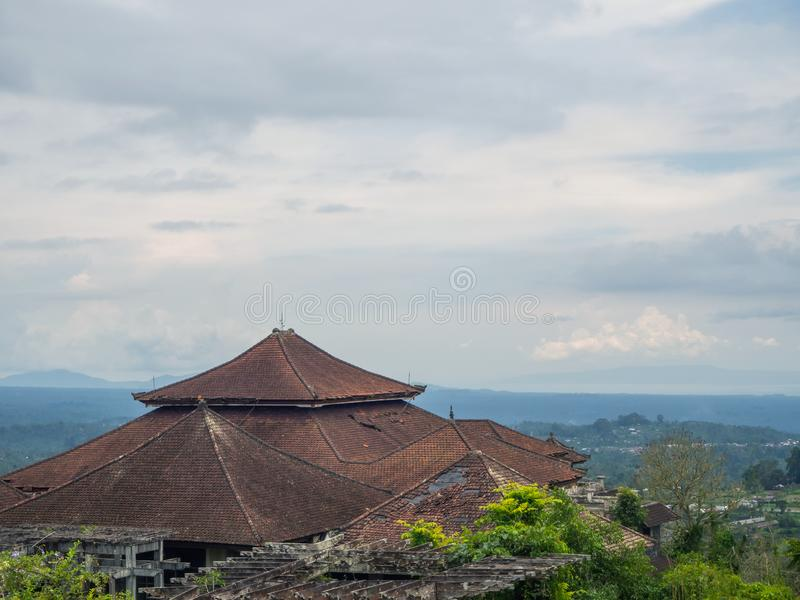 Red roofs of an abandoned hotel in Bali stock image
