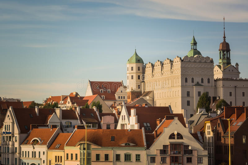 White castle and red roofs of residential houses in Szczecin, Poland. White castle with towers and green roofs and red roofs of residential and office houses in stock photography